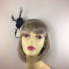 small fascinators for hair black ivory small fascinator with roses and feathers