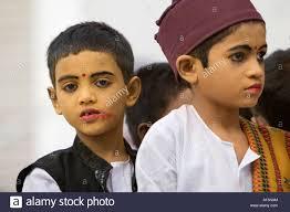indian boys performing in hindu play wearing gopi