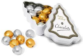 wrapped chocolate balls in a mini tree branded tin