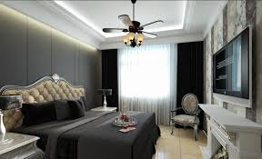 plain dark blue and brown bedroom bedding on black wood bed plus