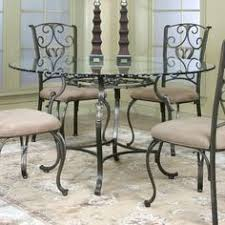 wrought iron dining table glass top bring the romantic look of wrought iron to the table with the greco