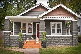 craftsman style home exteriors four white window along gray door
