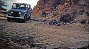 canyonlands utah 1971 jeep driving down the famous silver