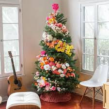 christmas tree decorating use flowers to decorate their christmas trees and it s beautiful