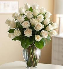 glass flower vase with white roses decorating your house using