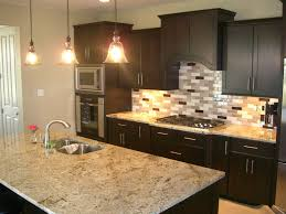 kitchen with stainless steel backsplash subway tile backsplash with dark cabinets sink faucet kitchen