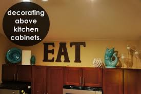 How To Decorate Above Kitchen Cabinets Reliefworkersmassagecom - Decor for top of kitchen cabinets