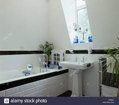 Bathroom With Black Walls White Tiled Bath Panel With Black Tiled Border In White Attic