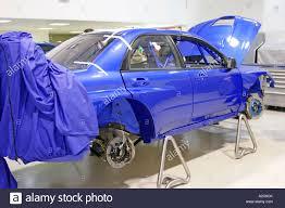 purple subaru impreza subaru impreza world rally car being prepared in swrt workshop at