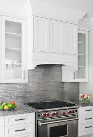white kitchen cabinets with stainless steel backsplash stainless steel backsplash contemporary kitchen