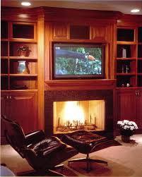 stone fireplace design ideas with tv above cable box over and