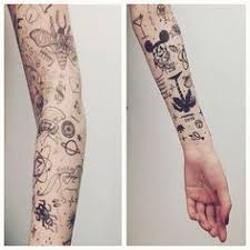the random tattoos up sleeves as much as the