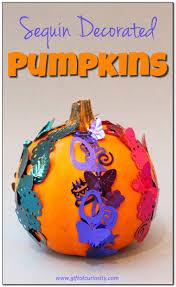 sequin decorated pumpkins for halloween