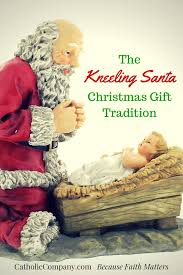 santa kneeling at the manger advent christmas traditions kneeling santa the catholic company