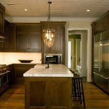 maple cabinets with black island maple kitchen cabinets with black countertops and backsplash