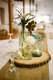 Rustic Mason Jar Centerpieces For Weddings by Rustic Mason Jar Centerpieces Love This Rustic Centerpiece With