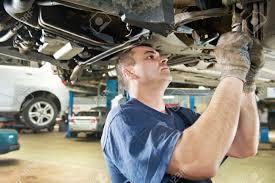 car suspension auto mechanic at car suspension repair work stock photo picture
