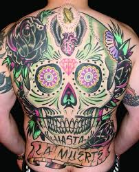 la muerte banner and sugar skull color ink tattoo on back