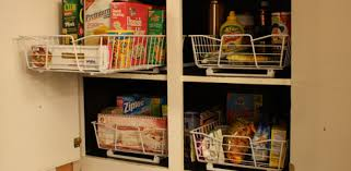 roll out shelves for kitchen cabinets how to add roll out wire baskets to kitchen cabinets today s homeowner