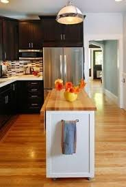 islands in small kitchens take a of stock furniture and it your own black accents