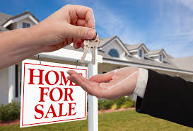 how to choose a real estate agent 4 brothers buy houses how to choose a real estate agent handing over the house keys in front of a beautiful new home
