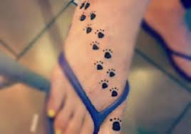 small paw tattoo on foot worlds style