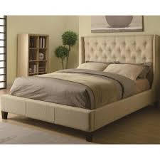 king upholstered headboard with grey wood frame and nightstand for