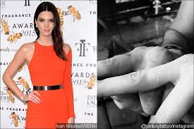 kendall jenner ignores kim kardashian u0027s tattoo warning gets tiny