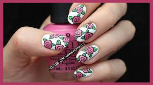 try out this unique and simple cartoon rose nail design