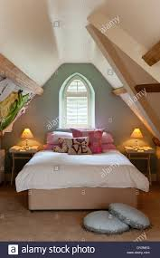 Attic Bedroom Girls Attic Bedroom With Sloping Walls And Arched Window Stock