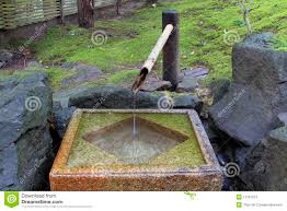 japanese bamboo fountain with stone basin stock image image