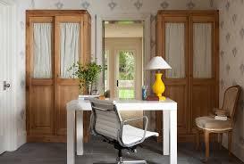 half closet half desk white lacquer desk in home office farmhouse with blue wallpaper next