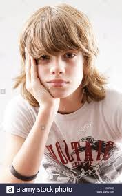 12 year old boy with long hair from book infestation 12 year old boy looking into the camera wresting his head in his