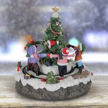 tree with revolving children battery powered with timer