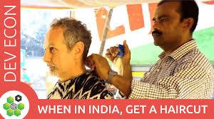 when in india get a haircut development economics videos