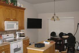 kitchen television ideas small flat tv for kitchen ideas multi function brown oak cabinet