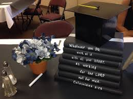 graduation centerpiece use black butcher paper as a runner on top use black butcher paper as a runner on top of a white table