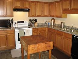 tuesday tours 6 kitchen not living vicariously the butcher block you see in the middle of the room came with my husband his father and sister bought it sometime somewhere many years ago