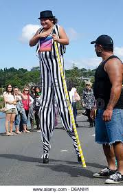 clown stilts clown stilts walker stock photos clown stilts walker stock