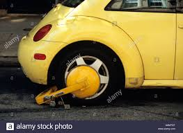 yellow volkswagen beetle royalty free yellow vw bug volkswagen boot booted tickets tow locked wheel tire