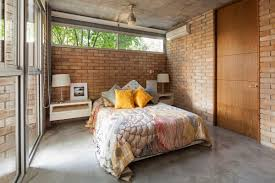 exposed brick wall lighting bedroom extraordinary beige hardwood modern painted door bedroom