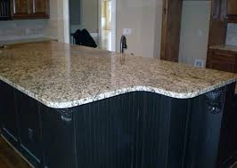 giallo fiorito granite with oak cabinets giallo veneziano with dark cabinets png