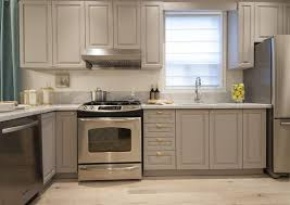 small kitchen grey cabinets small kitchen with gray cabinets and shiny brass hardware