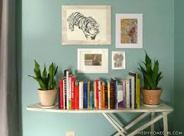 Distressed White Bookcase by Vintage Ironing Board Upcycled Into A Bookshelf U2013 The Decor Guru