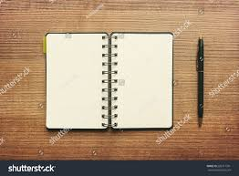 pen writing on paper notebook blank sheet paper pen on stock photo 286717391 shutterstock notebook with blank sheet of paper and pen on wooden table background writing idea concept