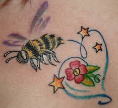 stars with flower and bee tattoo