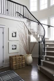 curved staircase black and white interiors entryways