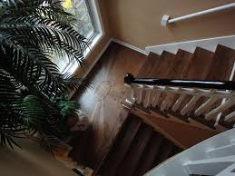 Stairs With Landing by Add Life To Your Staircase Landings With Custom Wood Floor Designs