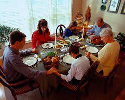 family at thanksgiving dinner thanksgiving traditions include expressing gratitude with sharing