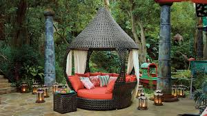 outdoor round rattan hanging chair brown finish black seat cushion